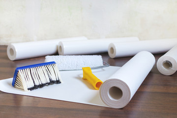 preparation for home repair, wallpaper rolls and brush on the floor