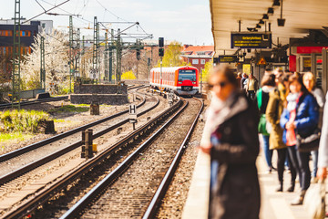 People waiting on the platform at train station