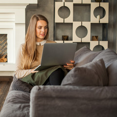 Young Model Using Laptop. Internet Shopping or Social Media Concept