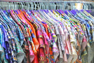 bright silk clothes on a hanger in the store