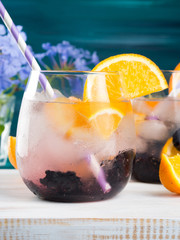 Alcohol Cocktail with blackberries and orange slices or infused detox water
