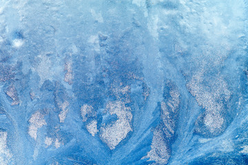 Frosty pattern on the window. Beautiful natural background. Winter theme. Close-up