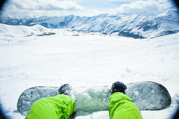 Snowboarder sitting on relax moment in mountain