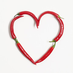 Red chili peppers arranged to make a heart shape