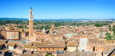 Panorama of Siena, aerial view with the Torre del Mangia (Mangia Tower) and Piazza del Campo (Campo square) , Tuscany, Italy