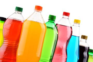 Plastic bottles of assorted carbonated soft drinks over white Fototapete