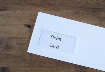 Paper envelope with debit  card inside