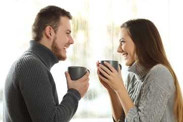 Couple in love looking each other in winter