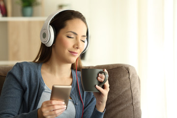 Relaxed girl listening to music with closed eyes