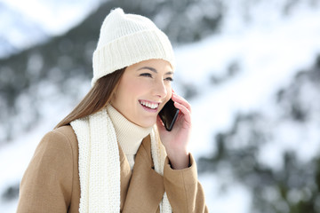 Woman having a phone conversation in winter holidays