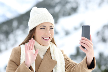 Tourist having a video call in winter holidays