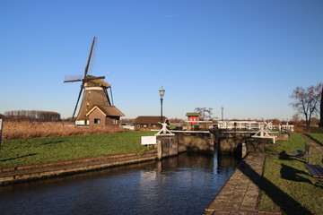 "Windmill ""eendragtsmolen"" in Zevenhuizen with ancient sluice"