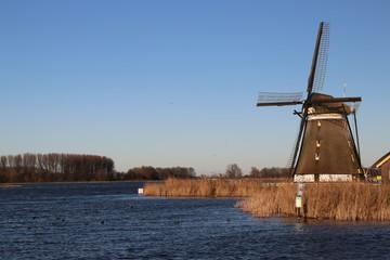 """Windmill """"eendragtsmolen"""" in Zevenhuizen with river Rotte"""