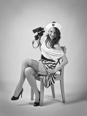 Beautiful woman with binoculars.