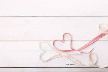 Two ribbon magic hearts on wooden backround, Valentine day concept