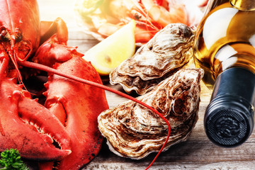 Steamed lobster and oysters with bottle of white wine