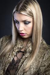 Portrait of a fashion model with a fur coat