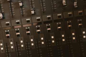top view of analog graphic equalizer at recording studio