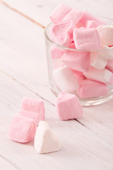 Marshmallows on wooden table.