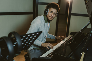 handsome smiling piano player performing song