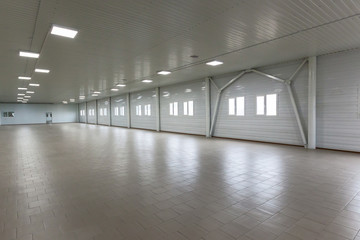 White room with windows and walls with sheathed plastic.White room