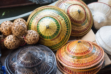 Hat-weaving, handmade goods, and is one of the souvenirs sold in the Damnoen Saduak floating market.