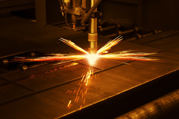 Industrial cnc plasma machine cutting of metal plate