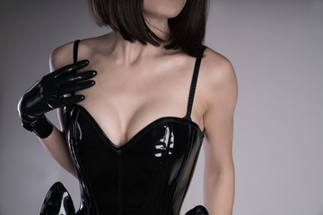 Close-up shot of sexy woman in fetish corset