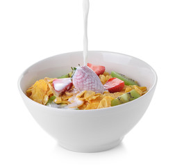 corn flakes with milk and fresh fruit on white background