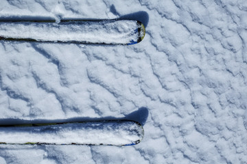 Skis on ski resort slope