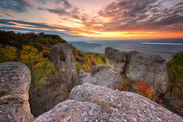 Autumn sunset / Magnificent view from a hill with an autumn forest at sunset