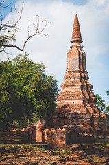 Aged Buddhist Stupa at Ayutthaya historical park in Thailand with fade out color effect