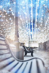 Nikolskaya street, Moscow, Russia. Glowing garland decoration. Christmas and New Year holidays