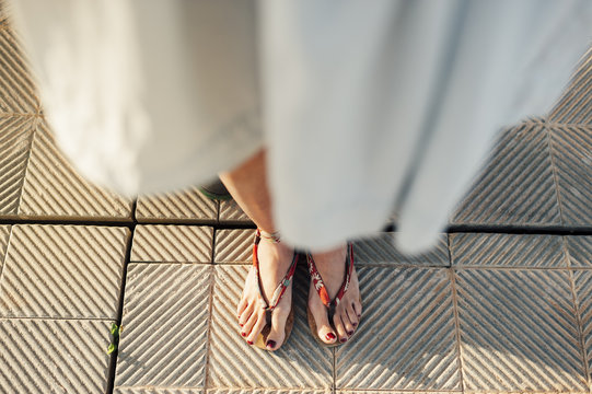 Close view of  woman feet wearing sandals in the street