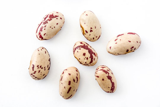 Raw pinto beans isolated on white background