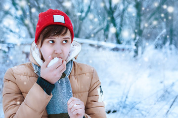 Outdoor closeup portrait of young beautiful woman on the background of snow