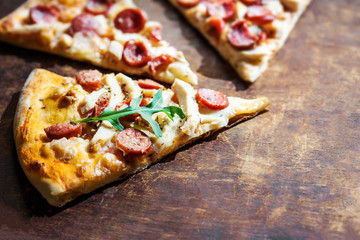 Hot Homemade Pepperoni Pizza Ready to Eat on wooden background.