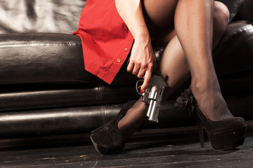 Female feet and revolver