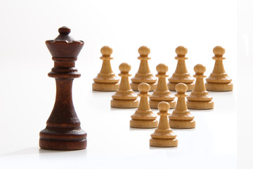 Business concept - chess - evil king and good employees - competition