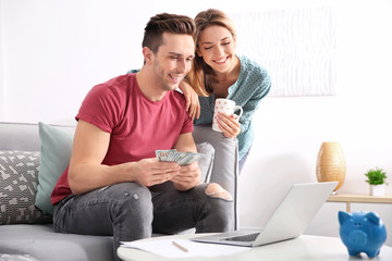 Young couple managing family budget at home