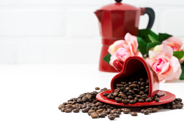 red cup and in the form of heart  and coffee beans on white background