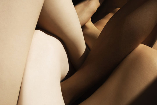 mixed skin color legs crossed