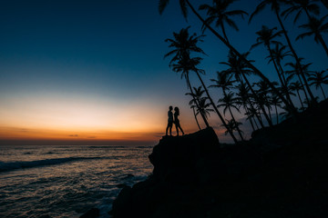 Silhouette of loving couple on sea