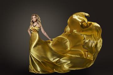Woman Gold Dress, Fashion Model Dancing in Long Artistic Evening Silk Gown, Waving Fly Fabric