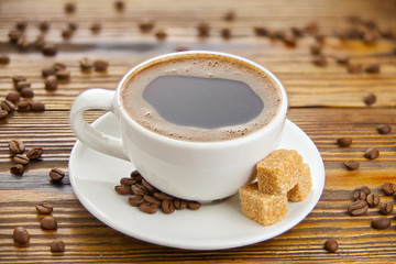 coffee in coffee cup with natural grains