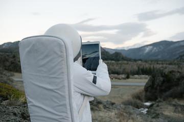 Astronaut taking mountain shots