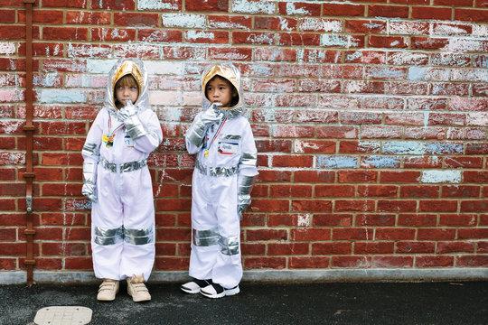 Two slightly worried little astronauts.