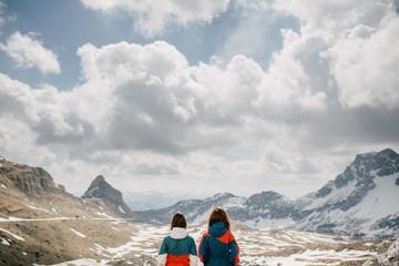 Friends hiking and enjoying mountain landscape