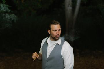 Man Smoking Cigar at Night