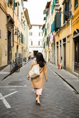 Young Filipino Woman Exploring Narrow Alley in Italy